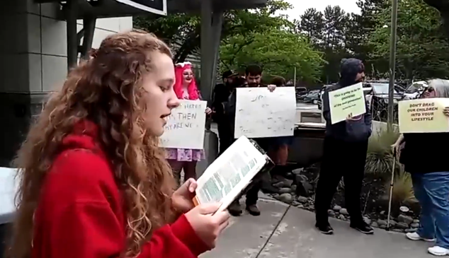 Girl in red coat reads bible